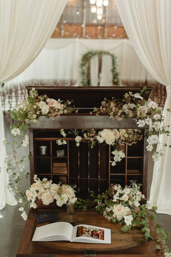 Estelle desk filled with flowers_Chantal Andrea Photography