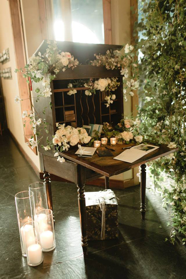 Vintage desk filled with flowers_Chantal Andrea Photography
