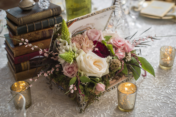 Vintage centerpiece featuring cigar box and books from Vintage Ambiance